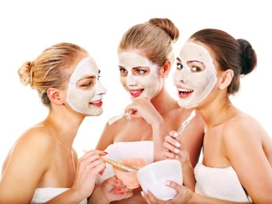 21546598 - young woman getting facial mask and gossip . isolated.